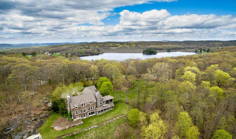 The lakehouse at 40 Spectacle Ridge Road in Kent offers sweeping views of Lake Waramaug and Kent's farmland, as well as access to South Spectacle Lake. Photo: Contributed Photo / The News-Times Contributed