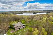 The lakehouse at 40 Spectacle Ridge Road in Kent offers sweeping views of Lake Waramaug and Kent's farmland, as well as access to South Spectacle Lake.