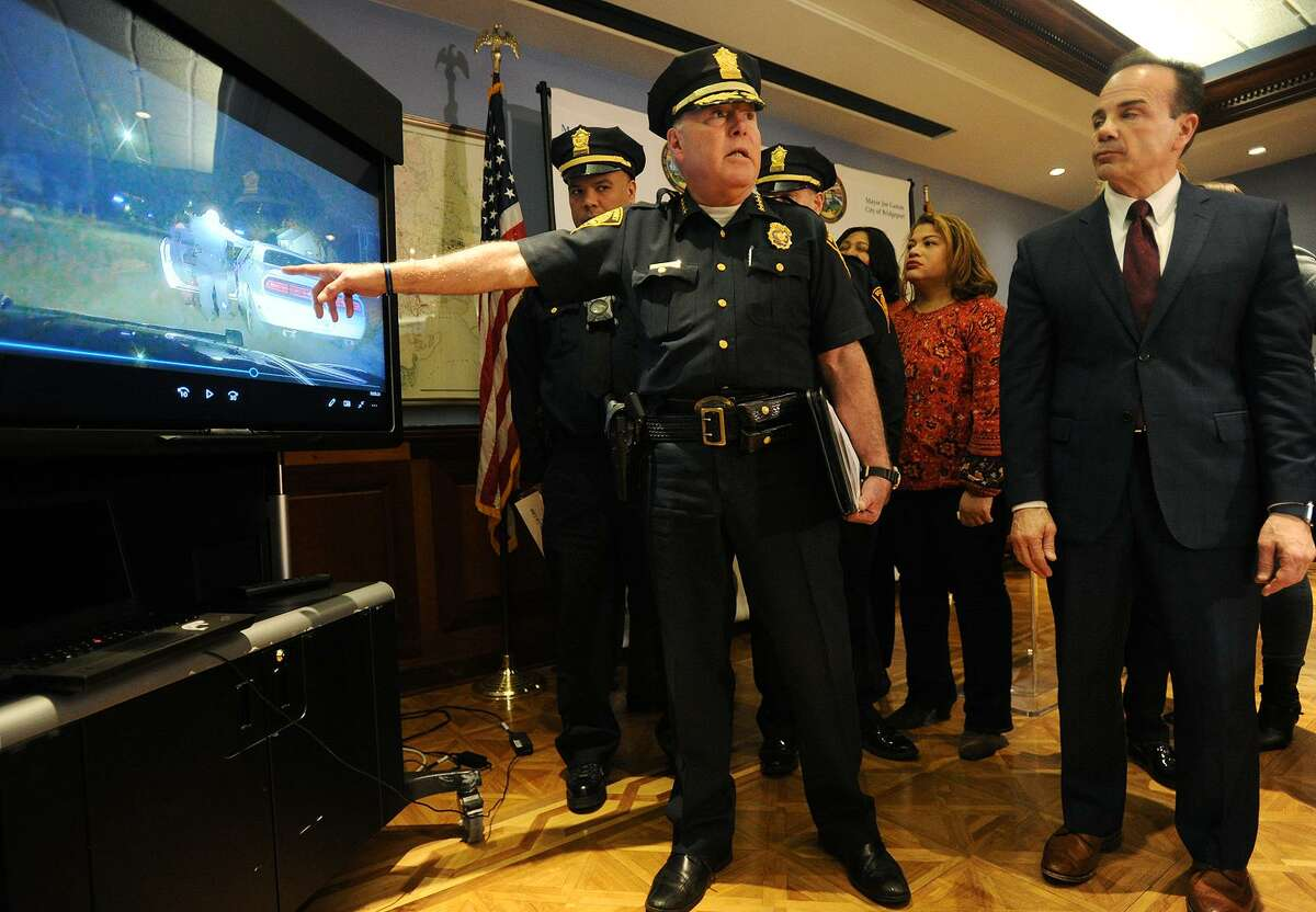 Bridgeport Police Chief A.J. Perez shows a video of the city's new police body and dash cameras in use during the program's announcement at the Margaret Morton Government Center in Bridgeport, Conn. on Tuesday, February 20, 2018.