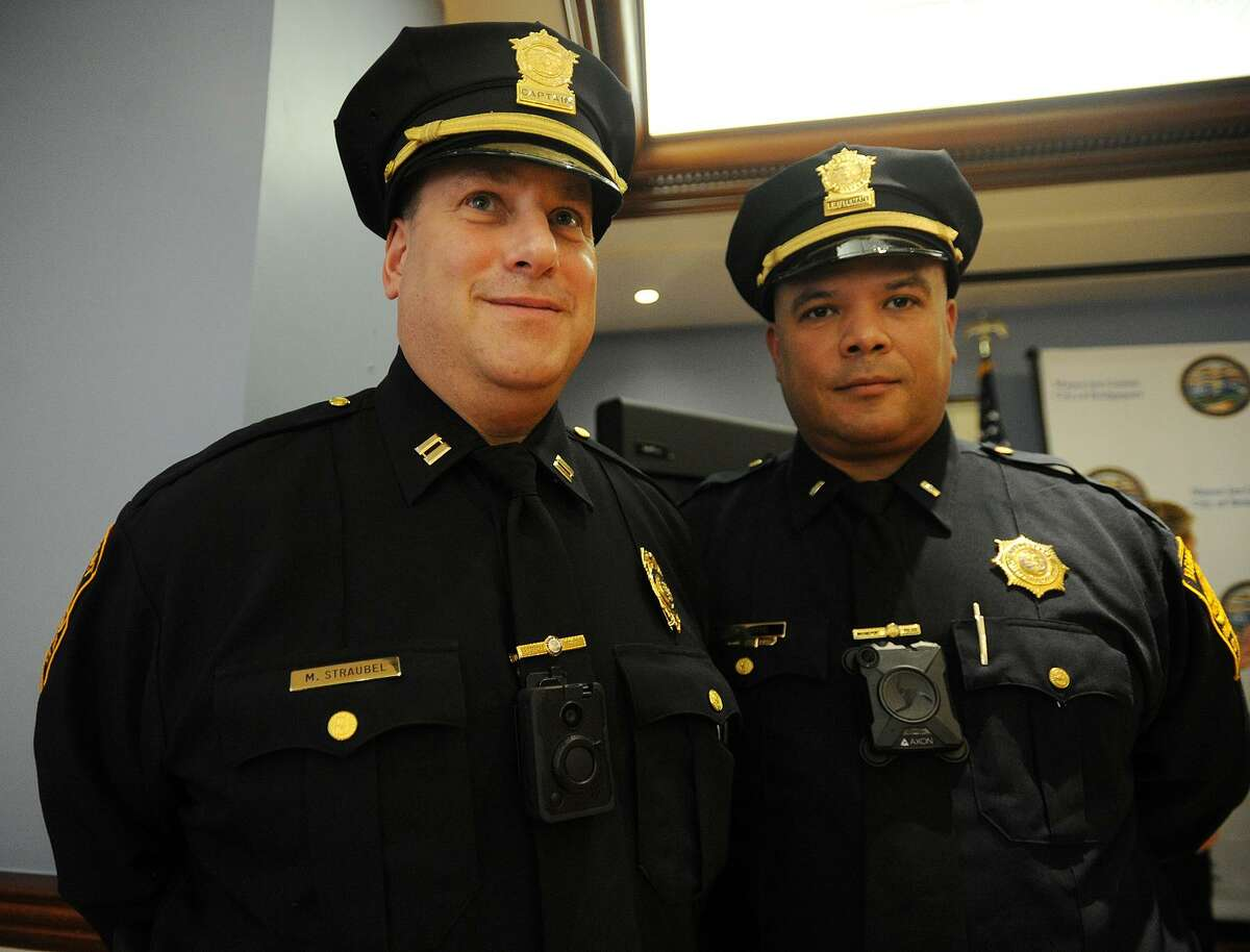 Bridgeport Police Captain Mark Straubel, left, and Lieutenant Manuel Cotto display the two types of body cameras being tested in the department's new program during the announcement at the Margaret Morton Government Center in Bridgeport, Conn. on Tuesday, February 20, 2018.