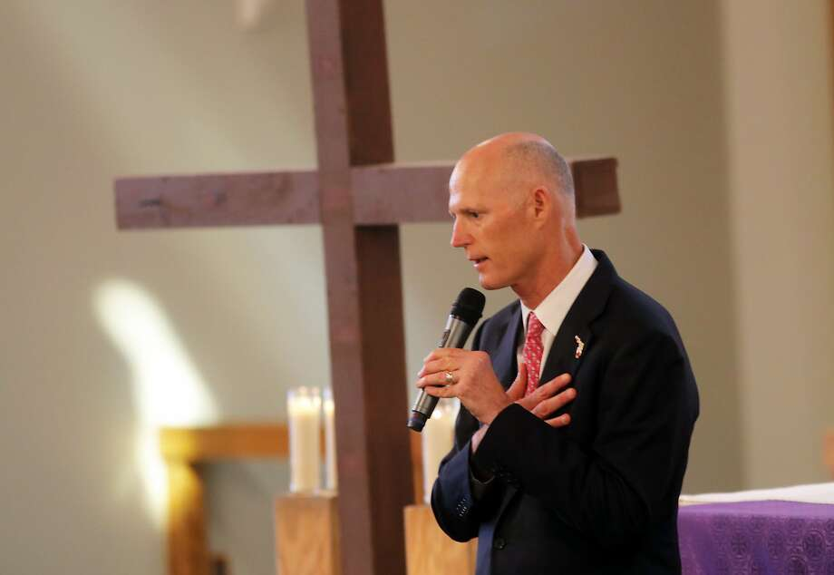 Florida Gov. Rick Scott addresses the congregation during a Sunday service dedicated to the school shooting victims. Photo: Gerald Herbert, Associated Press