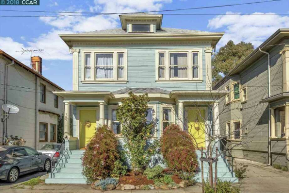 A lower-unit TIC in a Sears Roebuck kit house two blocks from Bart in Oakland is on the market for $569,000. Photo: Todd Taylor Photography