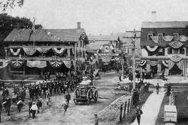 "The firemen's parade was one of the many special events held in New Milford more than 100 years ago. Shown above is the parade in the village center of New Milford, circa 1900, just pre-dating the Great Fire of 1902 that destroyed the New England House, left center, at the corner of Main and Bank streets. To the right is the United States Hotel, which was razed in 1927 on the present site of Robertson Jewelers. If you have a ""Way Back When"" photo you'd like to share, contact Deborah Rose at drose@newstimes.com or 860-355-7324."