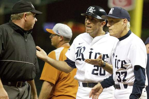 Rice manger Wayne Graham (37) and third base coach Patrick Hallmark talk with first base umpire Greg Oros after Oros ejected Rice third baseman Shane Hoelscher (2) at the end of the game during the Houston College Classic against the University of Texas at Minute Maid Park on Friday  March 2, 2012 in Houston, TX.   ( J. Patric Schneider / For the Chronicle )