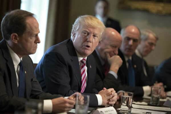 """President Trump meets with lawmakers to discuss trade policy at the White House. A reader is concerned about what he perceives to be an inordinate amount of """"Trump-bashing"""" in the newspaper."""