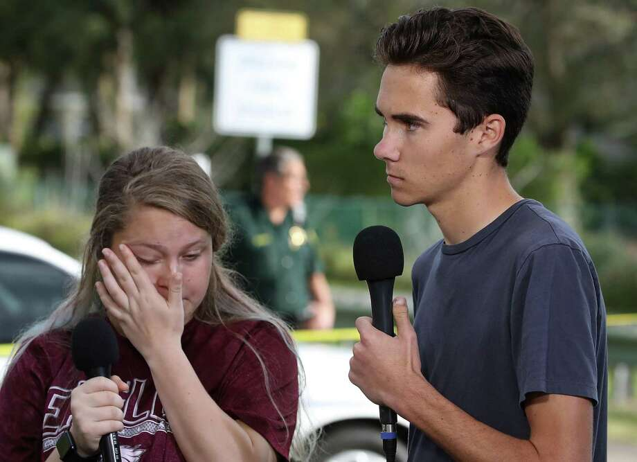 Students Kelsey Friend, left, and student news director David Hogg recount their stories about yesterday's mass shooting at the Marjory Stoneman Douglas High School where 17 people were killed, on Feb. 15 in Parkland, Florida. Hogg has been particularly articulate on the topic of guns. Photo: Mark Wilson /Getty Images / 2018 Getty Images