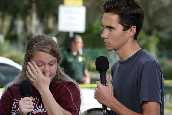 Students Kelsey Friend, left, and student news director David Hogg recount their stories about yesterday's mass shooting at the Marjory Stoneman Douglas High School where 17 people were killed, on Feb. 15 in Parkland, Florida. Hogg has been particularly articulate on the topic of guns.