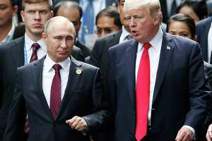 In President Trump's tweet-storm reaction to Special Counsel Robert Mueller's indictment of 13 Russians for interfering in last year's election, it's clear that either Trump has something very damaging to hide or he is not fit to lead after this nation has been attacked. Here, Trump and Russia's President Vladimir Putin talk as they make their way to and event during the Asia-Pacific Economic Cooperation leaders' summit recently.