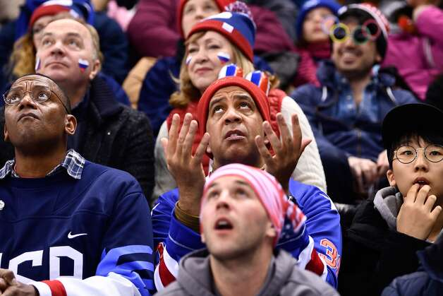US fans react during the men's ice hockey preliminary round group B game between the Olympic Athletes from Russia and the United States during the Pyeongchang 2018 Winter Olympic Games at the Gangneung Hockey Centre in Gangneung on February 17, 2018. Photo: BRENDAN SMIALOWSKI/AFP/Getty Images