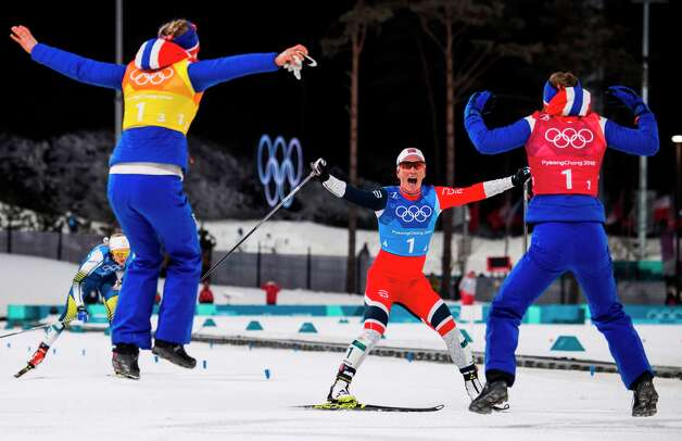 Norway's Marit Bjorgen (C) celebrates with her teammates after the women's 4x5km classic free style cross country relay at the Alpensia cross country ski centre during the Pyeongchang 2018 Winter Olympic Games on February 17, 2018 in Pyeongchang. Photo: JONATHAN NACKSTRAND/AFP/Getty Images