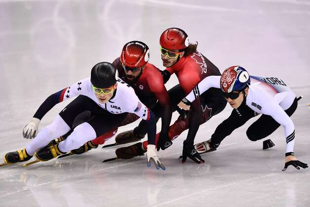 (L-R) USA's John-Henry Krueger, Canada's Charles Hamelin, Canada's Samuel Girard and South Korea's Seo Yira compete in the men's 1,000m short track speed skating semi-final event during the Pyeongchang 2018 Winter Olympic Games, at the Gangneung Ice Arena in Gangneung on February 17, 2018. Photo: ARIS MESSINIS/AFP/Getty Images