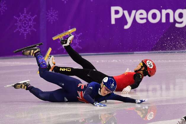 Britain's Elise Christie (L) and China's Li Jinyu fall in the women's 1,500m short track speed skating semi-final event during the Pyeongchang 2018 Winter Olympic Games, at the Gangneung Ice Arena in Gangneung on February 17, 2018. Photo: ROBERTO SCHMIDT/AFP/Getty Images
