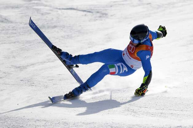 Italy's Luca de Aliprandini falls while competing in the Men's Giant Slalom at the Jeongseon Alpine Center during the Pyeongchang 2018 Winter Olympic Games in Pyeongchang on February 18, 2018. Photo: MARTIN BERNETTI/AFP/Getty Images