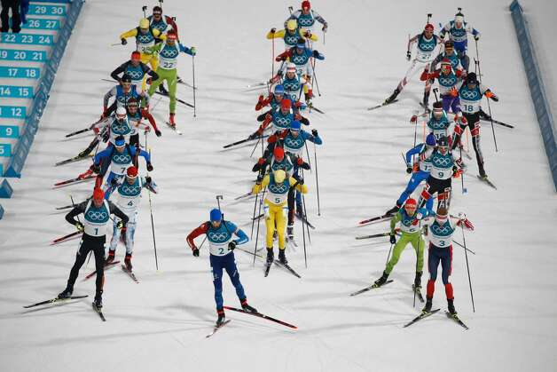Athletes take off at the start of the men's 15km mass start biathlon event during the Pyeongchang 2018 Winter Olympic Games on February 18, 2018, in Pyeongchang. Photo: ODD ANDERSEN/AFP/Getty Images
