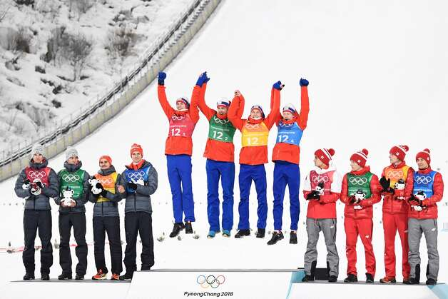 (From L) Silver medallist team Germany, gold medallists team Norway and bronze medallists team Poland celebrate on the podium during the victory ceremony in the men's large hill team ski jumping final round event during the Pyeongchang 2018 Winter Olympic Games on February 19, 2018, in Pyeongchang. Photo: JONATHAN NACKSTRAND/AFP/Getty Images
