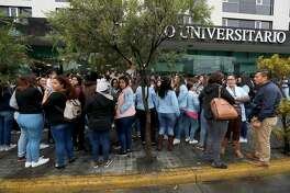 People remain outside a building, shortly after an earthquake rattled the Mexican city of Guadalajara, on February 9, 2018.  Reports of the national seismological service indicate that two quakes hit Guadalajara the first at 7:56 am with a magnitude of 4.5 degrees, and the second one at 8:05 in the morning reaching a magnitude of 5.9 with its epicentre in Cihuatlan Jalisco. / AFP PHOTO / ULISES RUIZULISES RUIZ/AFP/Getty Images