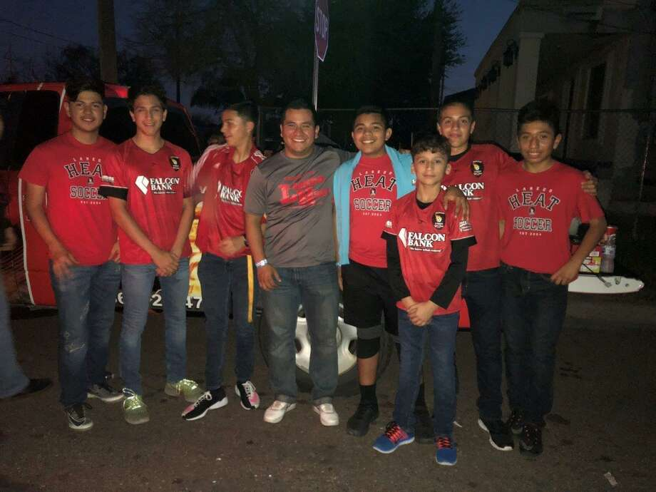 Coach Vincente Ruiz poses with Heat youth boys' players at the IBC Youth Parade. Photo: /Courtesy Photo