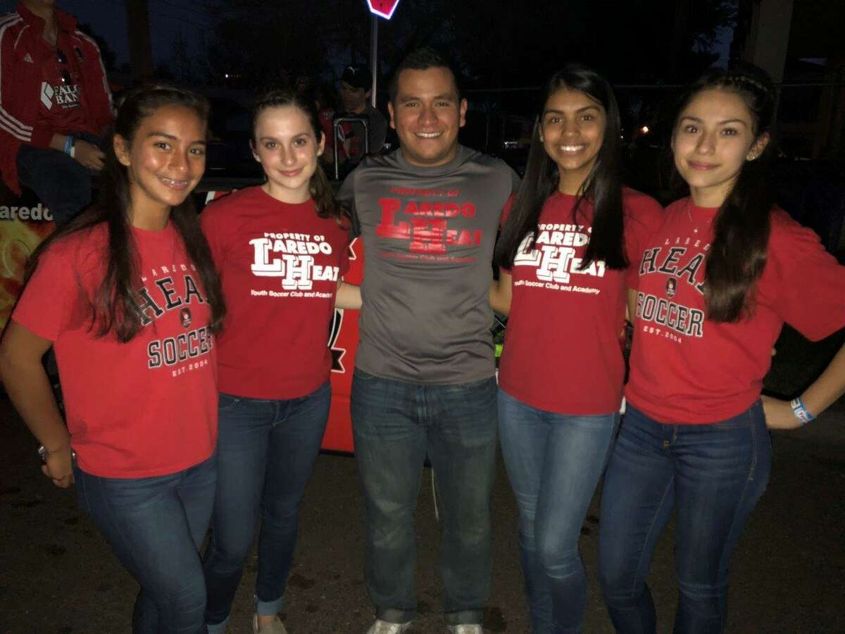 Coach Vincente Ruiz and four Heat youth girls' players at the IBC Youth Parade last week.