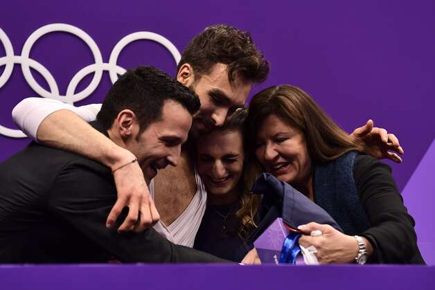 France's Gabriella Papadakis and France's Guillaume Cizeron react with their coaches after competing in the ice dance free dance of the figure skating event during the Pyeongchang 2018 Winter Olympic Games at the Gangneung Ice Arena in Gangneung on February 20, 2018. Photo: ARIS MESSINIS/AFP/Getty Images