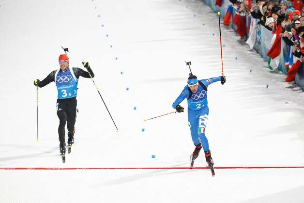 Bronze medallist Italy's Dominik Windisch crosses the finish line in front of Germany's Simon Schempp (L)  in the mixed relay biathlon event during the Pyeongchang 2018 Winter Olympic Games on February 20, 2018, in Pyeongchang. Photo: ODD ANDERSEN/AFP/Getty Images
