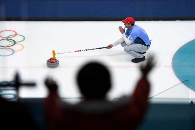 USA's John Shuster watches the stone during the curling men's round robin session between Switzerland and the US during the Pyeongchang 2018 Winter Olympic Games at the Gangneung Curling Centre in Gangneung on February 20, 2018. Photo: WANG ZHAO/AFP/Getty Images