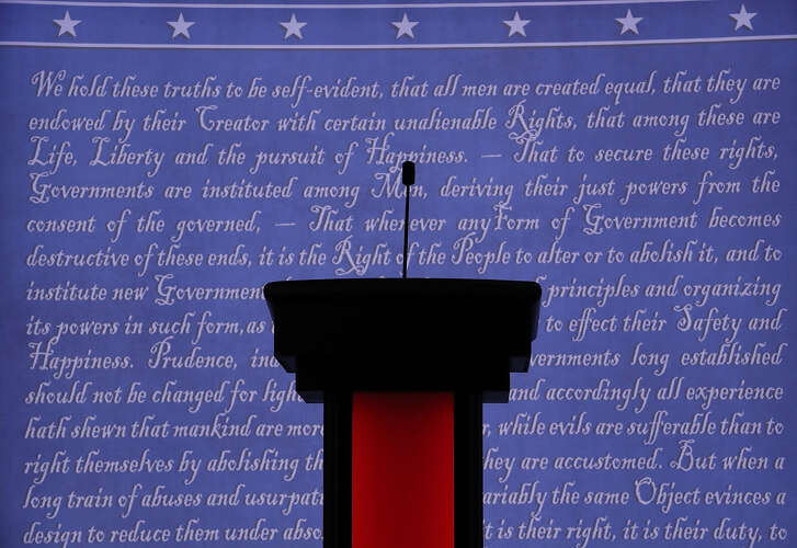 HEMPSTEAD, NY - SEPTEMBER 26: A candidate's podium is seen on the stage, where Democratic presidential candidate Hillary Clinton and Republican presidential candidate Donald Trump will participate in their first U.S. presidential debate at Hofstra University on September 26, 2016 in Hempstead, New York. Clinton and Trump continue to campaign against each other. (Photo by Joe Raedle/Getty Images)