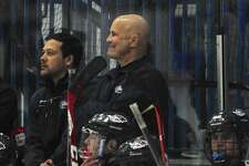 NFI coaches Tom Fabiani, left, and Larry Vieira watch their team during the boys hockey game between Sheehan and New Fairfield/Immaculate high schools on Wednesday night, January 6, 2015, at the Danbury Ice Arena, Danbury, Conn.
