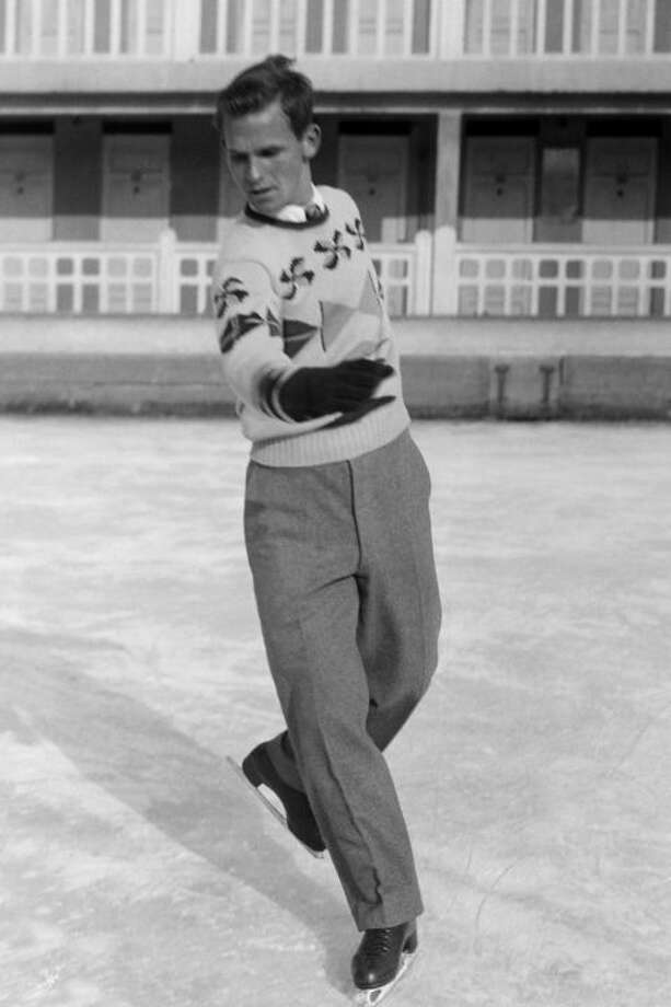 1) 1948: Dick Button American figure skaters didn't have the option of of wearing spandex 50 years ago. The fabric wouldn't be invented for a wholedecade. Luckily Dick Button secured the gold medal in Saint Moritz, Switzerland, wearing pleated trousers and a thick sweater, and repeated the feat fouryears later in Oslo, Norway.  Photo: Getty Images