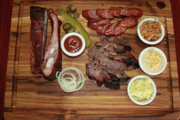 The El Monte BBQ menu keeps it simple with pork spare ribs, sausage and brisket as the only meat options. Sides include Spanish rice, creamed corn, potato salad and (not pictured) baked beans.