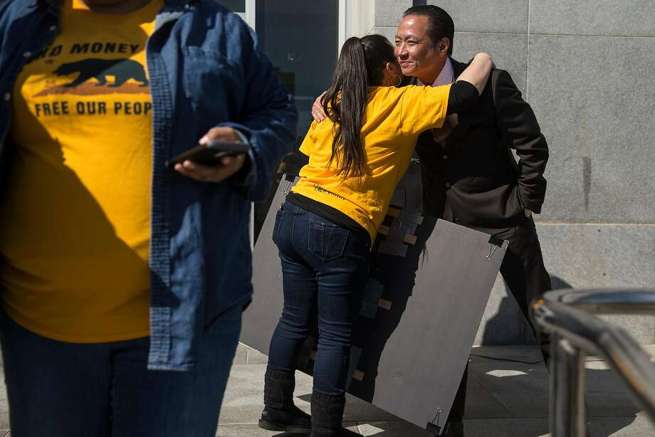 S.F. Public Defender Jeff Adachi hugs Amika Mota of Young Women's Freedom Center before a bail system protest rally. Photo: Jessica Christian, The Chronicle