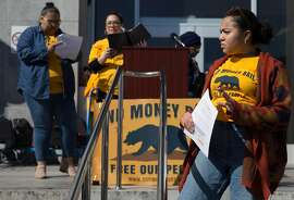 Lael Jones, 18, of Oakland stands on the steps of the Hall of Justice while attending a rally calling for the end of the money bail system in California Tuesday, Feb. 20, 2018 in San Francisco, Calif.