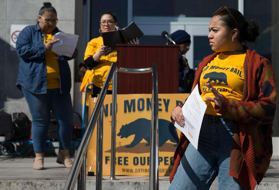 Lael Jones, 18, of Oakland stands on the steps of the Hall of Justice while attending a rally calling for the end of the money bail system in California Tuesday, Feb. 20, 2018 in San Francisco, Calif. Photo: Jessica Christian, The Chronicle