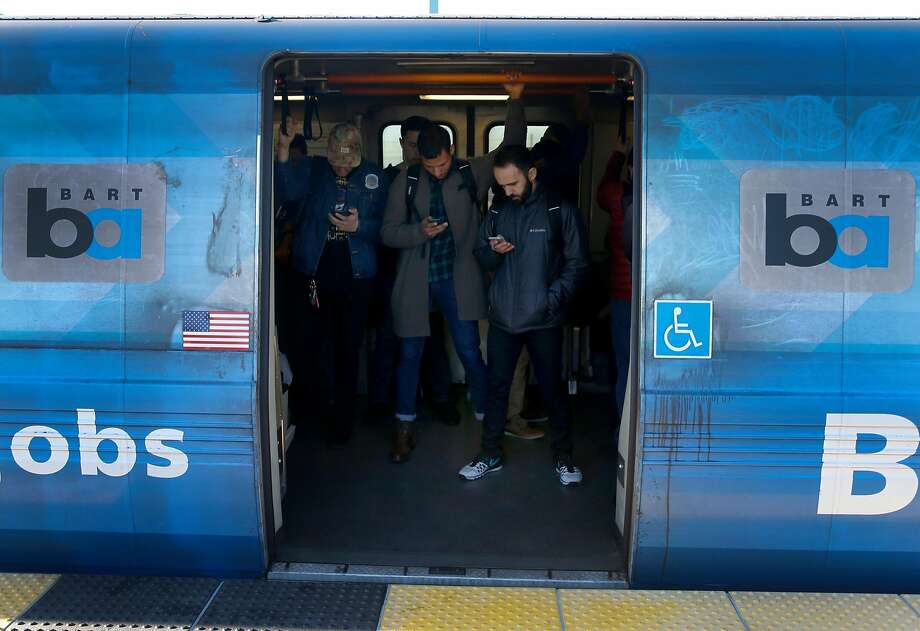 Passengers wait for a westbound train to depart the West Oakland BART station in Oakland, Calif. on Friday, Feb. 16, 2018. BART officials will begin a study on the feasibility of a second transbay tube. Photo: Paul Chinn, The Chronicle