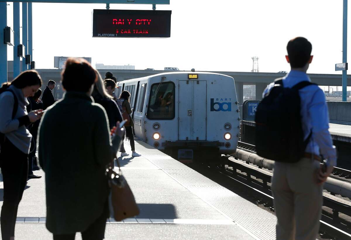 A westbound train arrives at the West Oakland BART station to pick up passengers in Oakland, Calif. on Friday, Feb. 16, 2018. BART officials will begin a study on the feasibility of a second transbay tube.