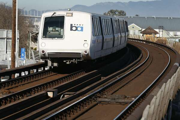 A BART train arrives at the West Oakland station after travelling through the transbay tube in Oakland, Calif. on Friday, Feb. 16, 2018. BART officials will begin a study on the feasibility of a second tube under the bay.