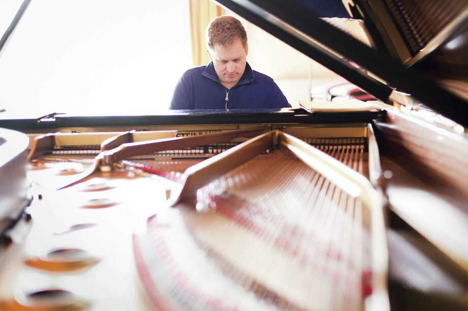 Andrew Armstrong, a New Canaan native and acclaimed pianist, will perform 4 p.m. Sunday at First Congregational Church. Photo: Contributed Photo / Benjamin Ealovega / Benjamin Ealovega 2015