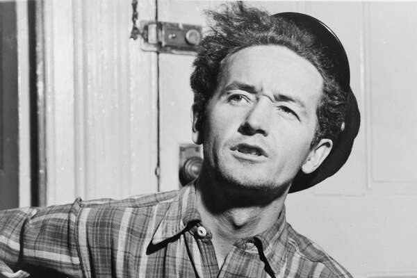 This circa 1943 photo courtesy of the Woody Guthrie Archives shows Oklahoma-born folk singer Woody Guthrie. The Woody Guthrie Center opens to the public on Saturday, April 27, 2013, with many interactive exhibits chronicling the life and work of Guthrie and is home to the folk singer�s archives. (AP Photo/Al Aumuller, Courtesy Woody Guthrie Archives)