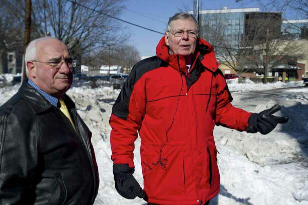 FILE — Stamford Mayor David Martin, right, and Director of Operations Ernie Orgera, left, talk about snow removal as city employees remove and relocate snow from Prospect Street and other downtown roads in advance of an oncoming snowstorm on Tuesday, February 11, 2014.