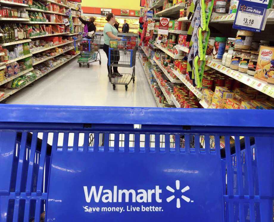 FILE- In this June 5, 2017, file photo, customers shop for food at Walmart in Salem, N.H. Walmart reports financial results Tuesday, Feb. 20, 2018. (AP Photo/Elise Amendola, File) Photo: Elise Amendola / Copyright 2017 The Associated Press. All rights reserved.