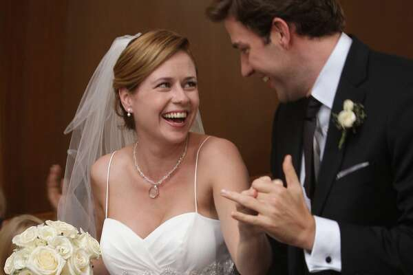6) 'The Office': Pam Beesly Jim and Pam were the couple you were rooting for on The Office. Their flirty co-worker relationship moved into dating territory, resulting in a romantic but unplanned gas station proposal, and culminating in the couple's Niagara Falls wedding in season 6. Pam wore this spaghetti-strap dress with a sweetheart neckline, a rhinestone necklace, and a short veil for the occasion.