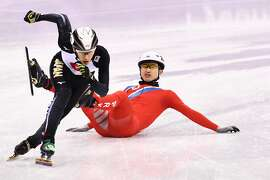North Korea's Jong Kwang Bom crashes in the men's 500m short track speed skating heat event during the Pyeongchang 2018 Winter Olympic Games, at the Gangneung Ice Arena in Gangneung on February 20, 2018.