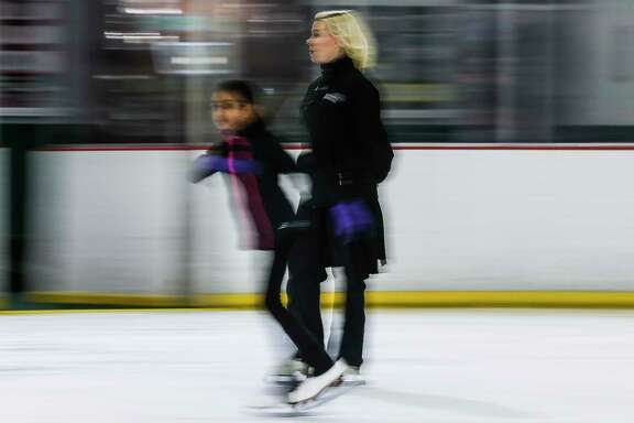 Former Olympic figure skater Katy Taylor skates across the ice as she teaches at the Aerodrome Ice Skating Complex Monday, Feb. 19, 2018 in Houston. (Michael Ciaglo / Houston Chronicle)