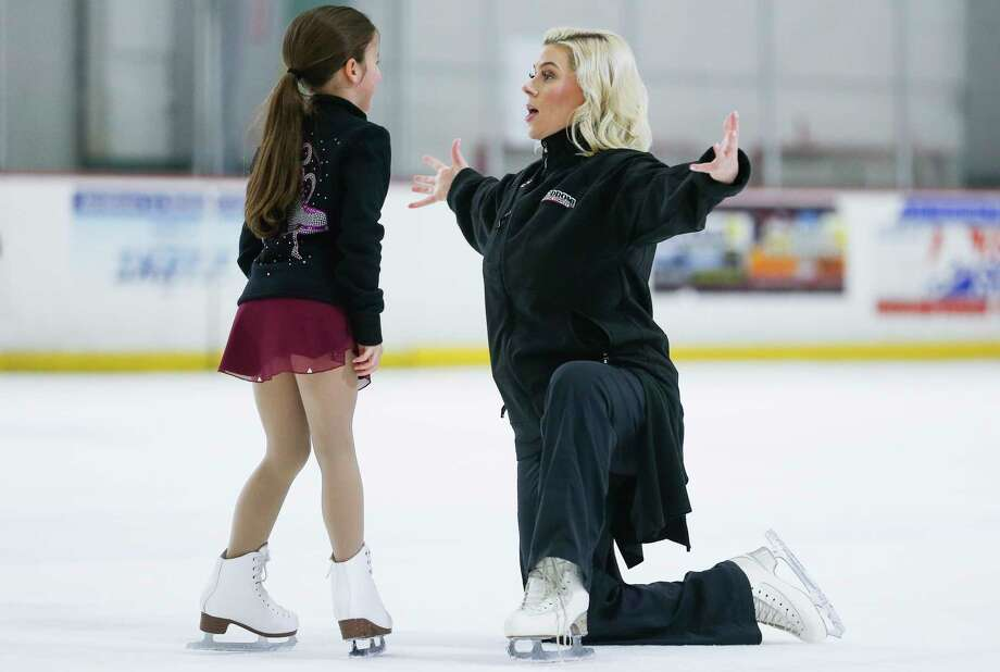 Former Olympic figure skater Katy Taylor, right, enjoys coaching youngsters like Olivia Henry, 8, at the Aerodrome Ice Skating Complex. Photo: Michael Ciaglo, Houston Chronicle / Michael Ciaglo