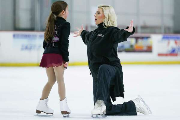 Former Olympic figure skater Katy Taylor, right, enjoys coaching youngsters like Olivia Henry, 8, at the Aerodrome Ice Skating Complex.
