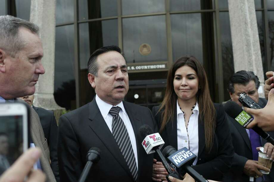 Standing with his wife, Lleanna Uresti, and his attorney Michael McCrum, Texas State Sen. Carlos Uresti talks with the media as they leave the John H. Wood, Jr., United States Courthouse for the day, Tuesday, Feb. 20, 2018. A week after his conviction, his wife has filed for divorce. Photo: JERRY LARA /San Antonio Express-News / © 2018 San Antonio Express-News