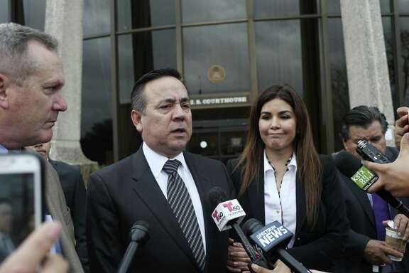 Standing with his wife, Lleanna Uresti, and his attorney Michael McCrum, Texas State Sen. Carlos Uresti talks with the media as they leave the John H. Wood, Jr., United States Courthouse for the day, Tuesday, Feb. 20, 2018. The jury started deliberating his criminal fraud trial. The charges stem from his involvement in the FourWinds Logistics company, a fracking sand venture. The company's consultant, Gary Cain, is a co-defendant in the case.