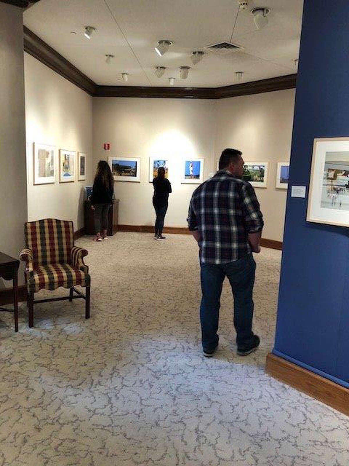 Student visitors examine paintings by artist/illustrator James Ransome now on display at the Abraham Art Gallery on WBU campus.