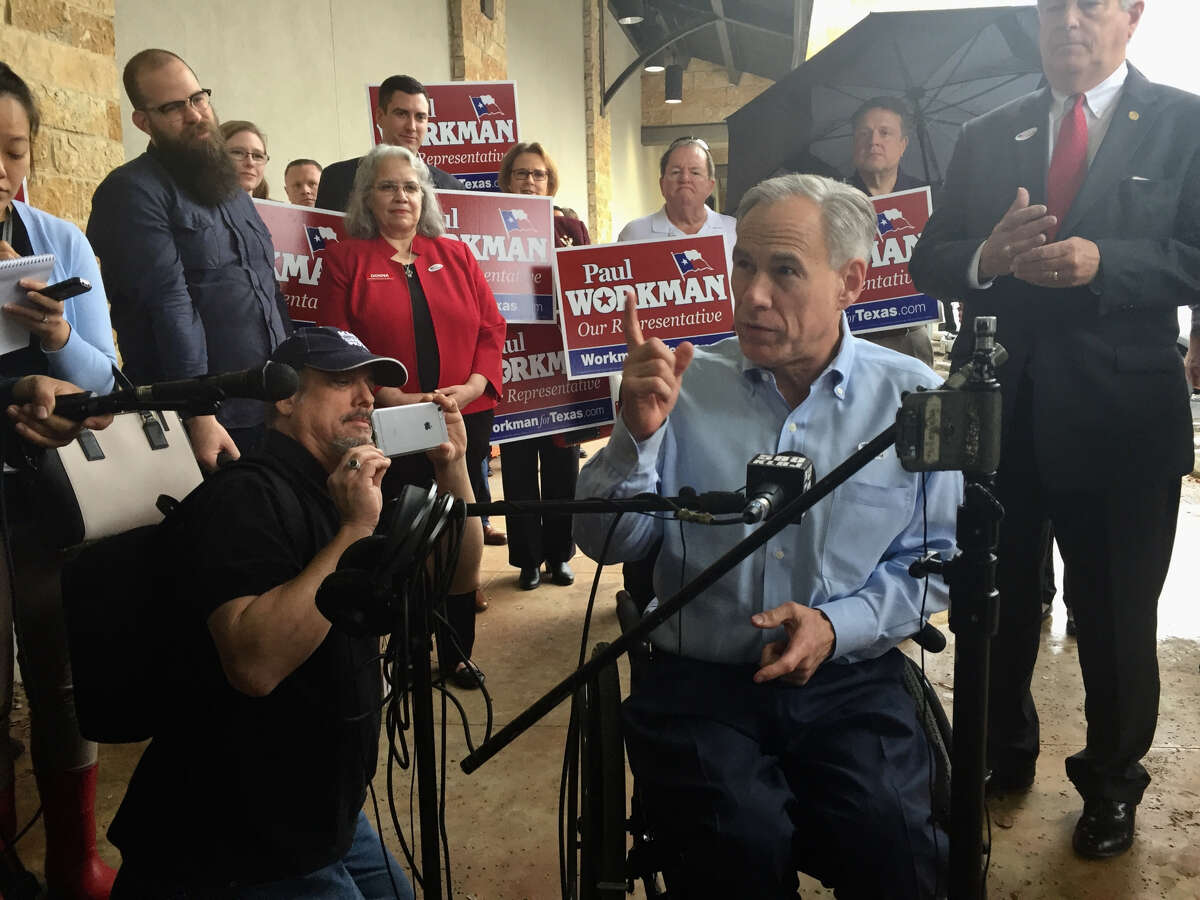 Texas Gov. Greg Abbott says he won't tell reporters who he voted for after casting an early election ballot in Austin on February 20, 2018, except that he voted for himself.