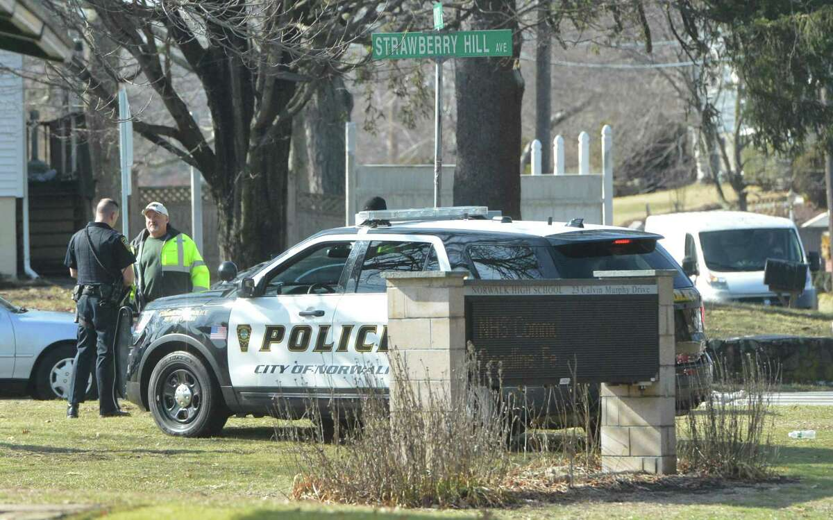 """Investigation prompts heavy police presence at Norwalk High School Norwalk High School was put on """"shelter in place"""" mode one February morning after school staff told a school resource officer that a student """"believed they had heard someone pulling the slide back on a handgun in the men's room within the school at 8:30 a.m. While no firearm was seen or threats made, 15 to 20 police officers - some with military-style rifles - conducted an investigation for several hours while students were sheltered in place. The event came six days after 17 students and educators in Parkland, Florida were shot in a high school massacre. Read more."""