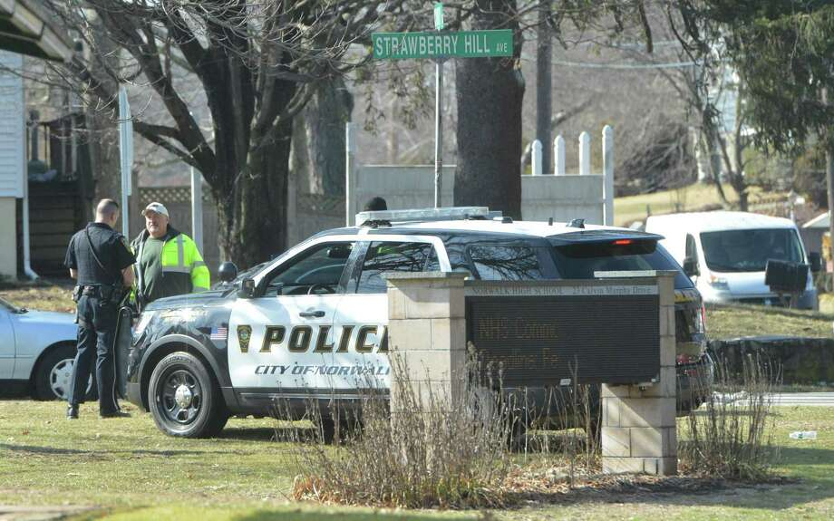 """Investigation prompts heavy police presence at Norwalk High School Norwalk High School was put on """"shelter in place"""" mode one February morning after school staff told a school resource officer that a student """"believed they had heard someone pulling the slide back on a handgun in the men's room within the school at 8:30 a.m. While no firearm was seen or threats made, 15 to 20 police officers — some with military-style rifles — conducted an investigation for several hours while students were sheltered in place. The event came six days after 17 students and educators in Parkland, Florida were shot in a high school massacre. Read more. Photo: Alex Von Kleydorff / Hearst Connecticut Media / Norwalk Hour"""